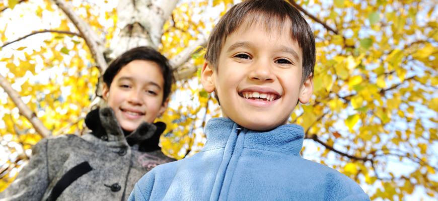 image of smiling children in park